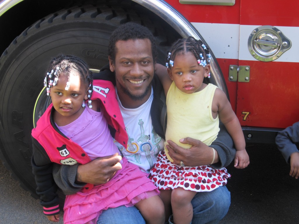 ather and two daughters with firetruck
